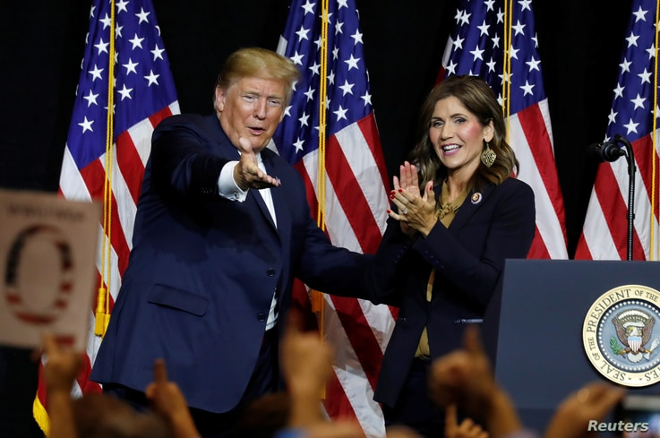 FILE- President Donald Trump and Governor Kristi Noem.