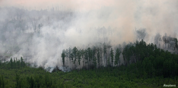 FILE PHOTO: An aerial view shows the Taiga wood burning near the village of Boguchany, about 560 km (348 miles) northeast of…