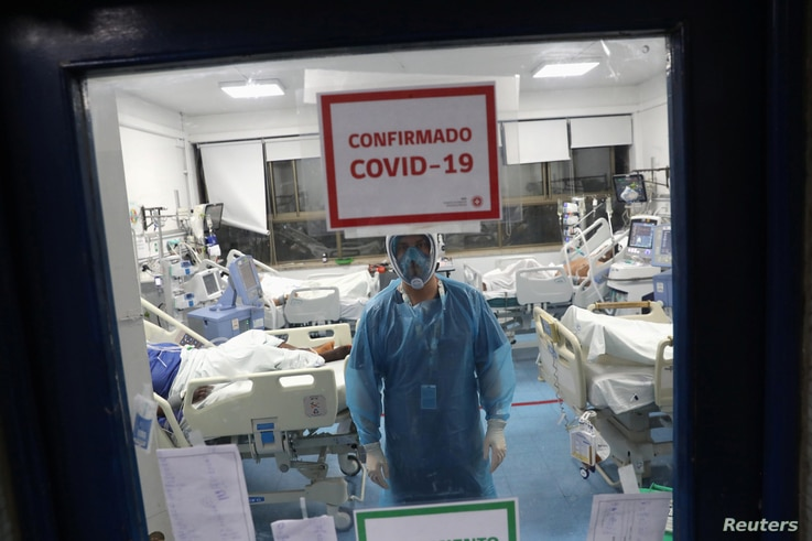A health worker takes care patients infected with the coronavirus disease (COVID-19) inside an Intensive Care Unit of the Posta…