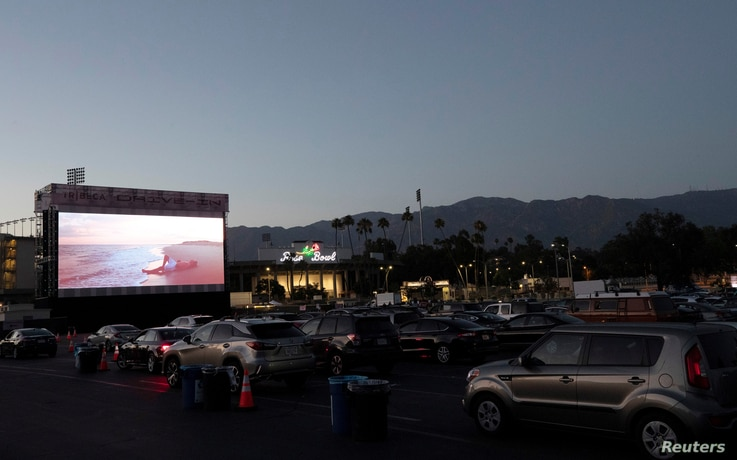 """People watch the movie """"Jaws"""" at The Tribeca Drive-In outside Rose Bowl stadium during the outbreak of the coronavirus disease."""