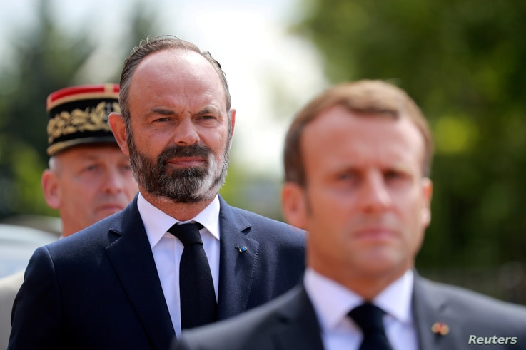 FILE - French President Emmanuel Macron and French Prime Minister Edouard Philippe.