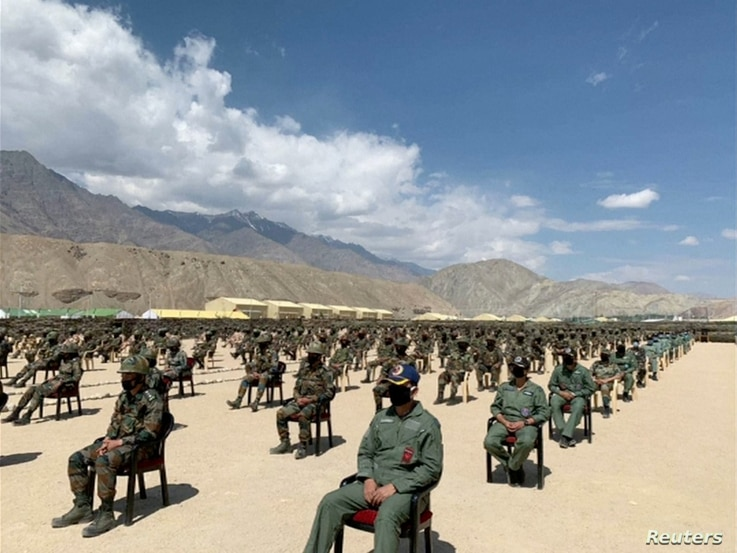 Soldiers await a visit by India's Prime Minister Narendra Modi in India's Himalayan desert region of Ladakh, India, July 3,…