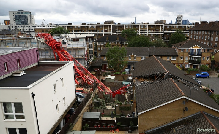 A collapsed crane is seen at a construction site in Bow, east London, Britain, July 8, 2020. REUTERS/Hannah McKay