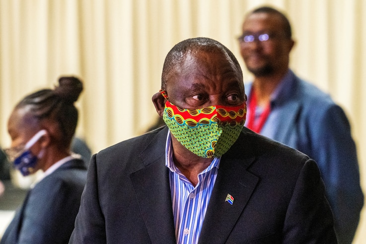 FILE - South African President Cyril Ramaphosa visits the coronavirus disease (COVID-19) treatment facilities at the NASREC Expo Centre in Johannesburg, South Africa, April 24, 2020.