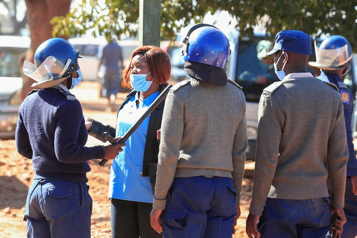 FILE PHOTO: Police arrest a health worker during a protest against economic hardship and poor working conditions during the…