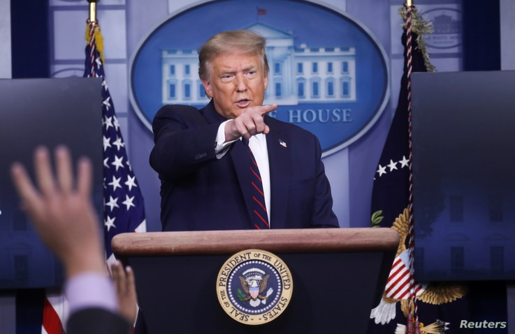U.S. President Donald Trump points to a reporter for a question during a coronavirus disease (COVID-19) response news briefing…