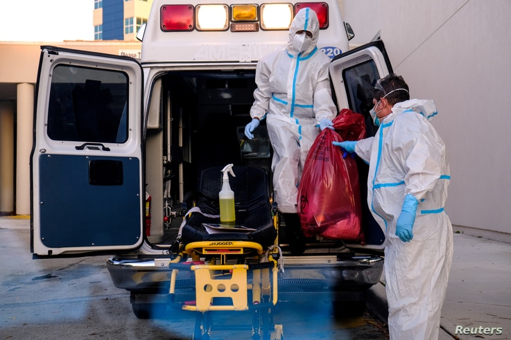 FILE PHOTO: EMTs cleanse their materials outside Memorial West Hospital where coronavirus disease (COVID-19) patients are…