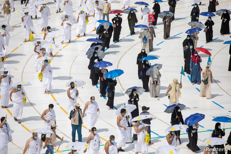 Muslim pilgrims maintain social distancing as they circle the Kaaba at the Grand mosque during the Haj pilgrimage,   July 29, 2020.