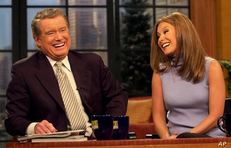 """Host Regis Philbin shares a laugh with new co-host Kelly Ripa during a broadcast of """"Live with Regis and Kelly"""" Monday, Feb. 5,…"""