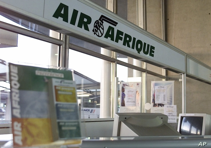 An empty counter of Air Afrique airline is pictured at Roissy airport in Paris Wednesday, June 13, 2001.  African heads of…