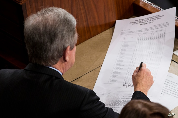 Sen. Roy Blunt, R-Missouri, signs an official tally to count Electoral College votes, certifying Donald Trump's presidential victory, Jan. 6, 2017.