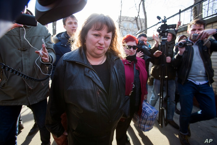 Oksana Sevastidi, center, surrounded by journalists, leaves the Lefortovo prison in Moscow, Russia, Sunday, March 12, 2017…