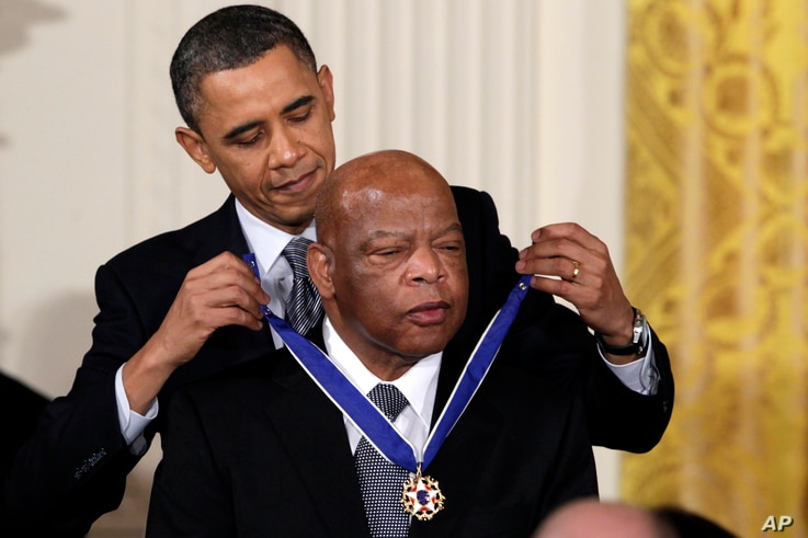 FILE - Former President Barack Obama presents a 2010 Presidential Medal of Freedom to U.S. Rep. John Lewis, D-Ga., during a ceremony in the East Room of the White House in Washington,Feb. 15, 2011.