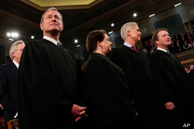 From left, Supreme Court Chief Justice John Roberts, Associate Justice Elena Kagan, Associate Justice Neil Gorsuch and…
