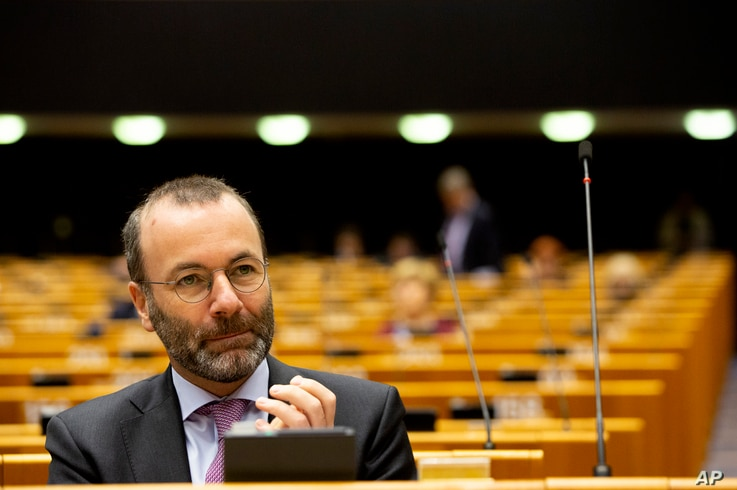 German MEP Manfred Weber attends a session in the Plenary chamber of the European Parliament in Brussels, Tuesday, March 10,…