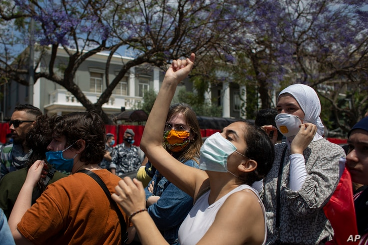 Anti-government protesters wearing masks to help protect themselves from the coronavirus shout slogans during ongoing protests against the Lebanese government outside the military court in Beirut, Lebanon, May 7, 2020.