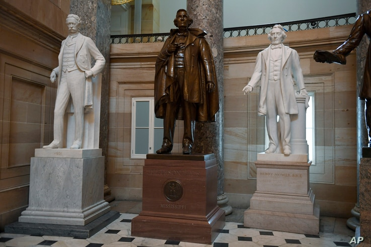 A statue of Jefferson Davis of Mississippi is on display in Statuary Hall on Capitol Hill in Washington, Thursday, June 11,...