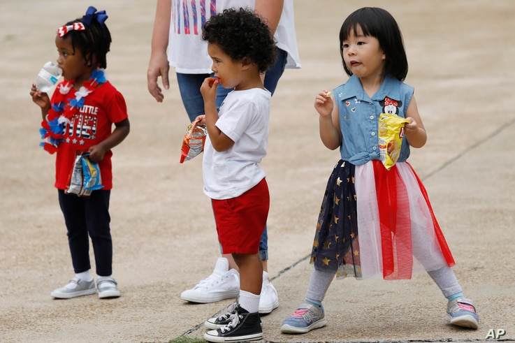 Children enjoy an early Fourth of July celebration in Jackson, Miss., June 26, 2020.