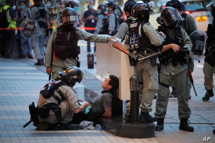 Police detained a protester during a march marking the anniversary of the Hong Kong handover from Britain to China, Wednesday, July. 1, 2020, in Hong Kong.