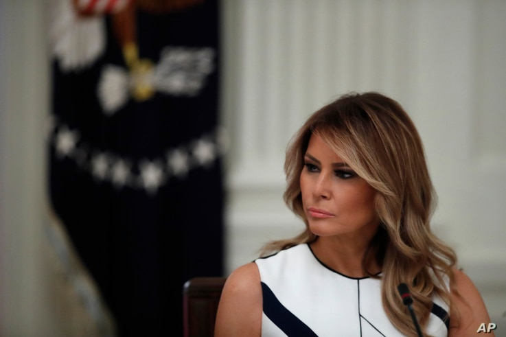 "First lady Melania Trump listens as President Donald Trump speaks during a ""National Dialogue on Safely Reopening America's…"