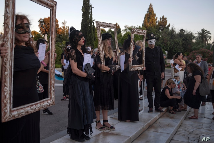 School teachers dressed in black take part in a demonstration against new protest law in Athens, on Thursday, July 9, 2020. …