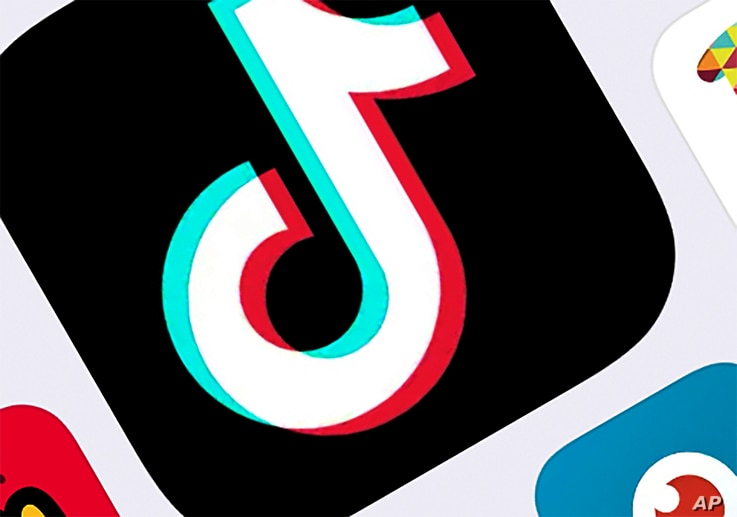 FILE - This Feb. 25, 2020, file photo, shows the icon for TikTok in New York. Amazon has told employees to delete the popular…