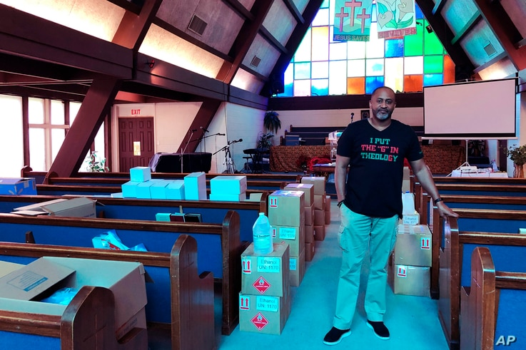 Earle Fisher, a pastor and civil rights activist, poses inside Abyssinian Missionary Baptist Church on Sunday, July 12, 2020,…