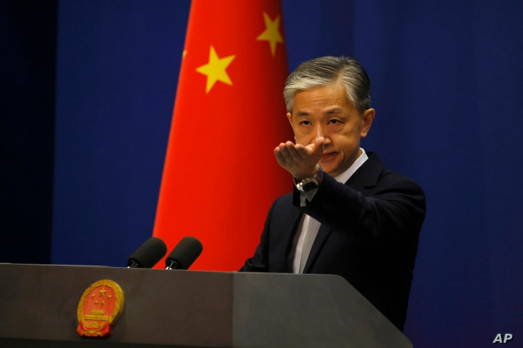 Foreign Ministry spokesperson Wang Wenbin gestures for questions during the daily briefing in Beijing on Thursday, July 23,…
