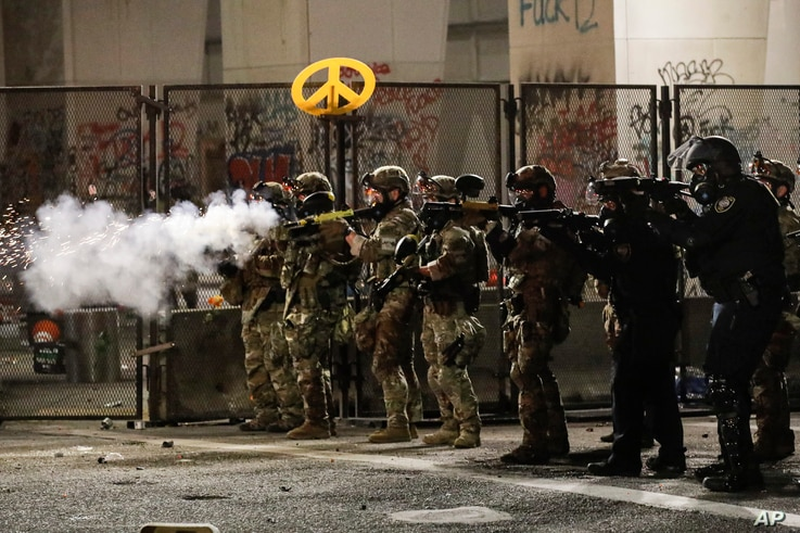Federal agents use crowd control munitions to disperse Black Lives Matter demonstrators during a protest at the Mark O. Hatfield United States Courthouse, July 24, 2020, in Portland, Oregon.
