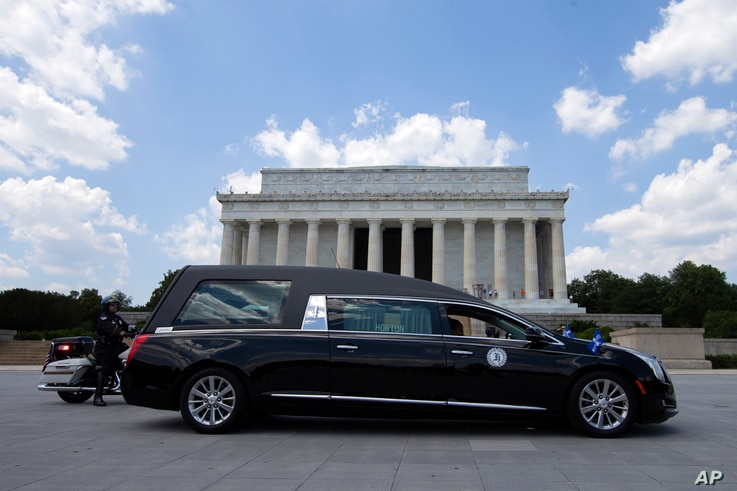 A hearse with the flag-draped casket of Rep. John Lewis, D-Ga., pauses in front of the Lincoln Memorial, Monday, July 27, 2020,…