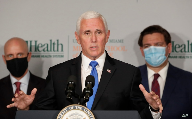 Vice President Mike Pence, center, gestures as he speaks during a news conference with Food and Drug Administration…