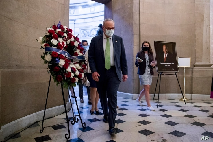 Senate Minority Leader Sen. Chuck Schumer of N.Y. walks to the office of House Speaker Nancy Pelosi of Calif., on Capitol Hill…