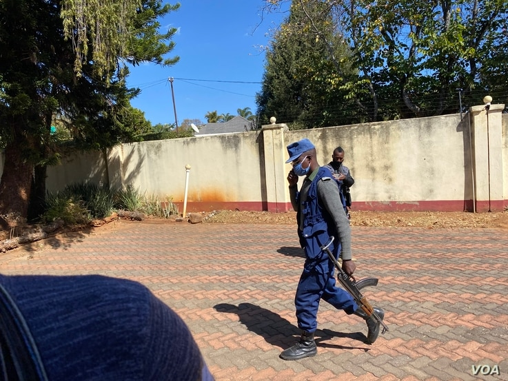 Armed police guarding journalistic equipment of Hopewell Chin'ono in Harare, July 21, 2020. (VOA/Columbus Mavhunga)