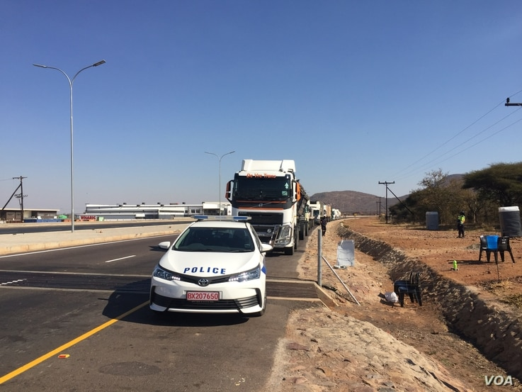 Botswana police escort all trucks entering the country from South Africa. (Mqondisi Dube/VOA)