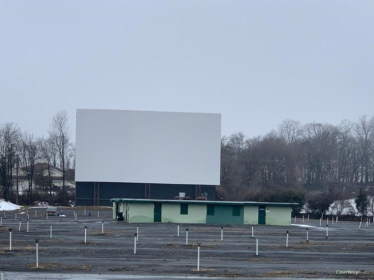 Empty Haar's Drive-in lot and large movie screen.  (Photo courtesy Haar's Drive-In Theater)