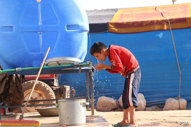Yasser, 12, says, on July 24, 2020, he tries to keep clean because of the coronavirus, in Idlib, Syria.