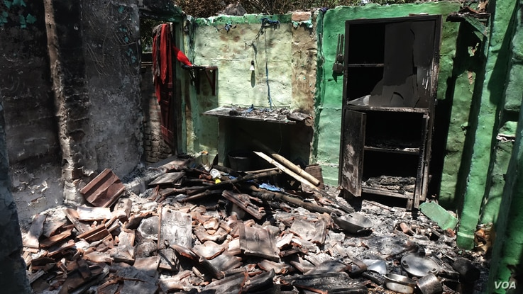 The charred room of a Muslim jute mill laborer in Telinipara, two days after it was set aflame by a Hindu mob during communal violence on May 12. During three days of violence, rioters destroyed dozens of houses and shops. (Alex Simon/VOA)