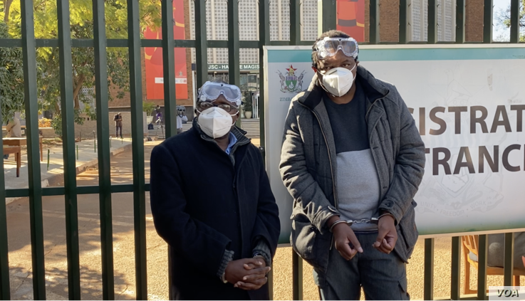 Transform Zimbabwe's Jacob Ngarivhume  and reporter Hopewell Chin'ono outside Harare Magistrates Court on July 22, 2020 in Harare. (Photo: Columbus Mavhunga/VOA)