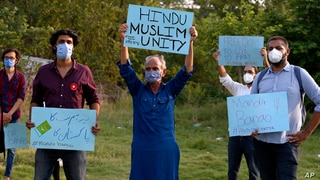 Members of a civil society group hold a demonstration demanding the government allow the construction of a Hindu temple, in…