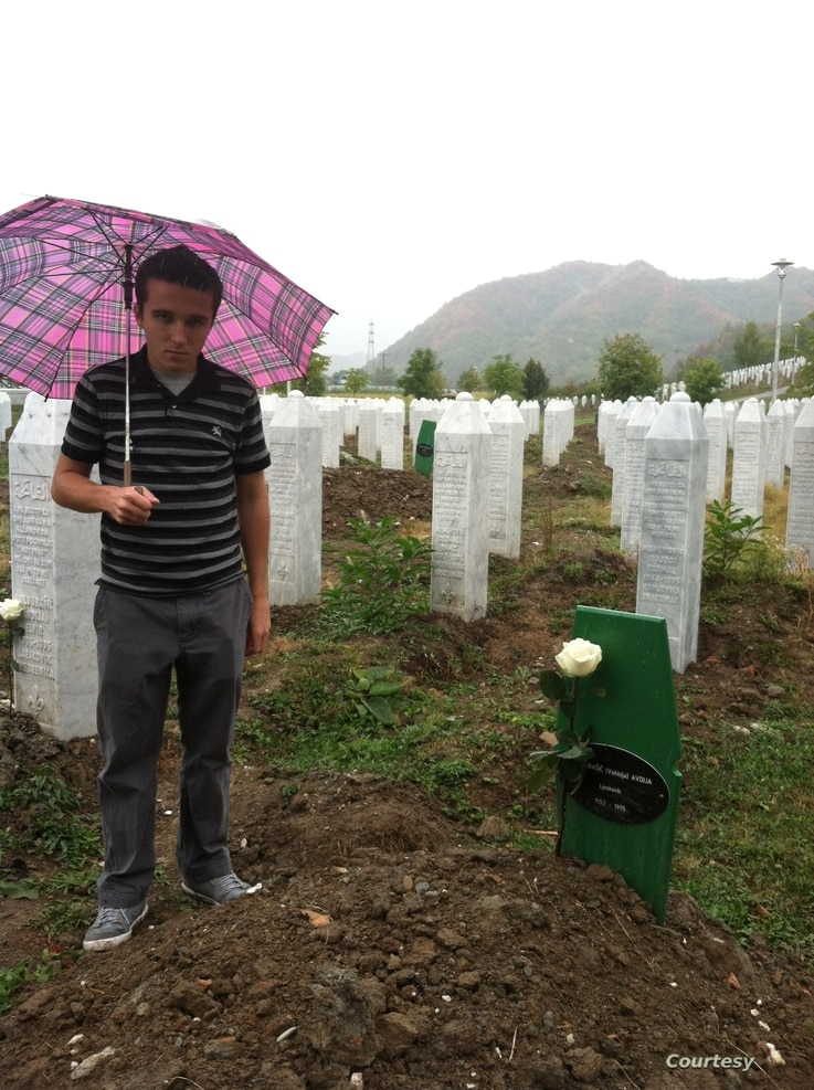 Behidin Piric, a survivor of the Srebrenica Genocide of 1995, stands next to the grave of his aunt's husband