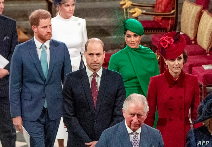FILE - Britain's Prince Harry (L) and Meghan (2nd R) follow Prince William (C), and Catherine (R) as they depart Westminster Abbey after attending the annual Commonwealth Service in London, March 9, 2020.