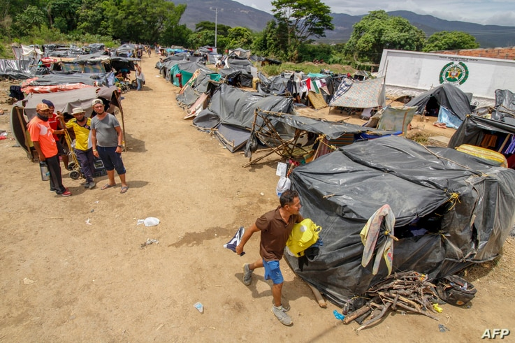 Venezuelan migrants attempting to return to their country due to the COVID-19 pandemic remain in makeshift camps at the Simon Bolivar International Bridge in Cucuta, Colombia, July 7, 2020.