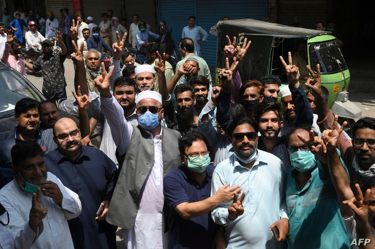 Traders gesture as they protest near their closed shops against a coronavirus lockdown imposed by the Punjab provincial government ahead of the Muslim festival Eid-al-Adha, in Lahore, Pakistan, July 28, 2020.