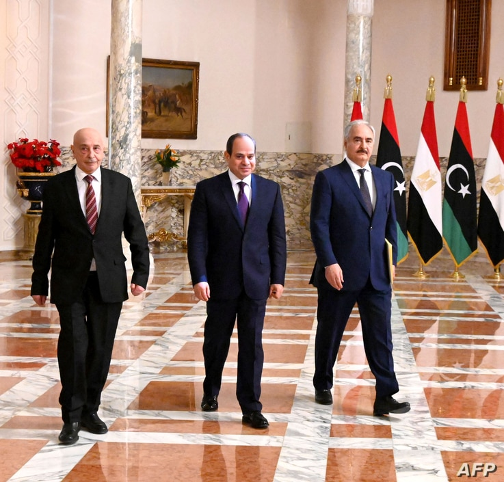 FILE - A handout picture released by the Egyptian Presidency June 6, 2020, shows Egyptian President Abdel Fattah al-Sissi (C), Libyan commander Khalifa Haftar (R) and Libyan Parliament speaker Aguila Saleh arriving for a press conference in Cairo.