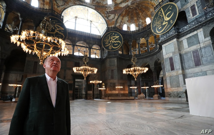 This handout picture released by the Turkish Presidential press office shows Turkish President Tayyip Erdogan visiting Hagia Sophia in Istanbul, July 19, 2020.