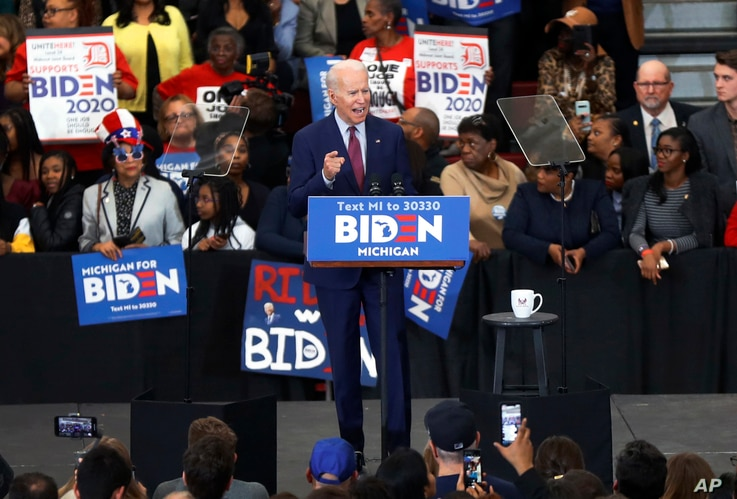 FILE - Democratic presidential candidate former Vice President Joe Biden speaks during a campaign rally at Renaissance High School in Detroit, Michigan, March 9, 2020.