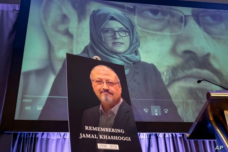 FILE - In this Nov. 2, 2018, photo, a video image of Hatice Cengiz, fiancee of slain Saudi journalist Jamal Khashoggi, picured below, is displayed during a memorial event in Washington, Oct. 2, 2018.