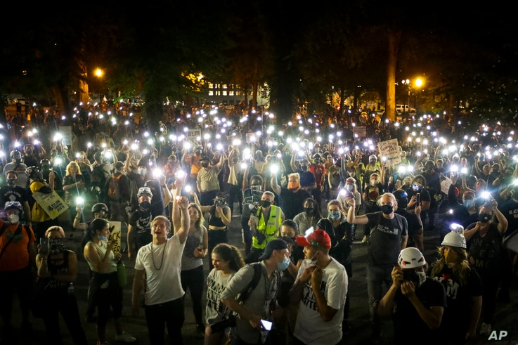 Demonstrators chant slogans during a Black Lives Matter protest at the Mark O. Hatfield United States Courthouse, July 29, 2020, in Portland, Oregon.