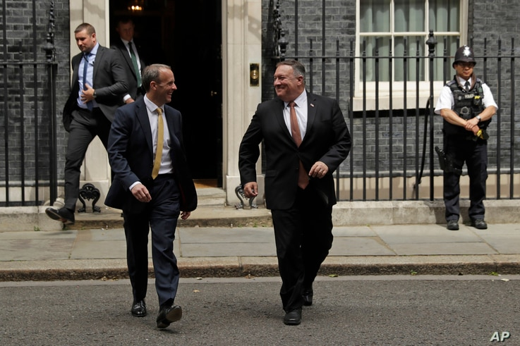 British Foreign Secretary Dominic Raab, left, walks with U.S. Secretary of State Mike Pompeo outside of 10 Downing Street, in London, July 21, 2020.
