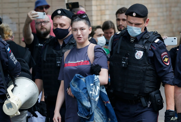 Police detain RT Television channel journalist Maria Sherstyukova during a rally to support Ivan Safronov near the Lefortovo prison in Moscow, Russia.